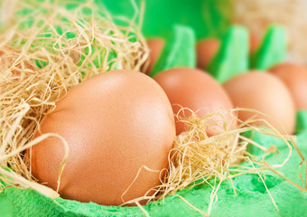 Eggs in green egg box close up