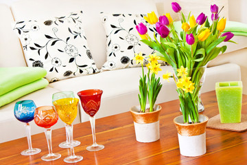 Springtime decorations with flowers and glasses