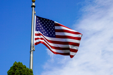 USA flag on the blue sky