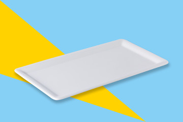 Empty white plate on blue yellow popart  background