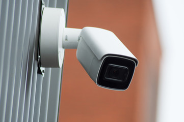 closeup of security camera on modern building