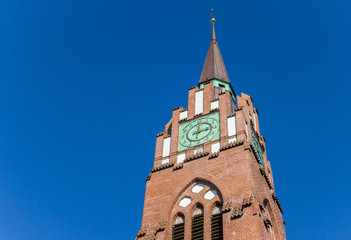 Fototapete - Tower of the historic Stadtkirche church in Jever, Germany