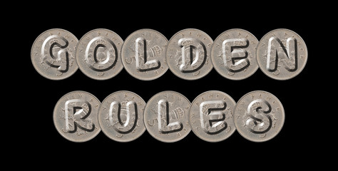 GOLDEN RULES – Coins on black background