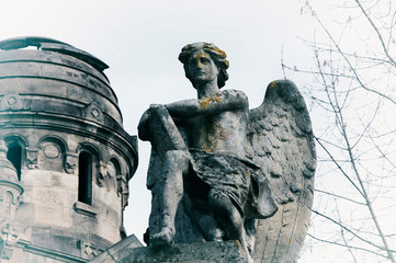 Angel of death with a book of life against the background of the ruins of an old church (Azrael, Azriel, Malak al-maut, concept of death)