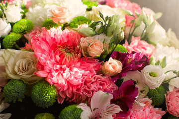 Many colored flowers.Bouquet of roses and pions