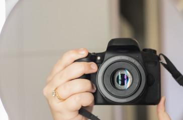 digital dslr camera in hand