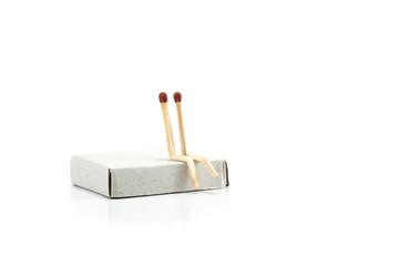 Safety Matches showing metaphor, Two safety matches, gay couple in love sitting together. Closeup photography, isolated on white background