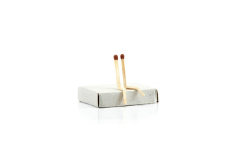 Safety matches showing metaphor, emotion, two safety matches, couple sitting together. Close up photography, isolated on white background