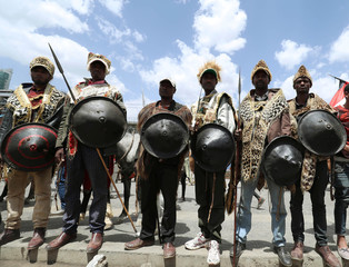 Ethiopian Men pose dressed in traditional costumes during the 123rd anniversary celebration of the battle of Adwa where the Ethiopian forces defeated an invading Italian forces, in Addis Ababa