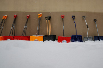 Snow shovels are displayed for sale during a winter snow storm in Arlington