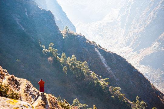 Monk in Himalaya mountains in early morning. Tengboche. Everest region, Nepal