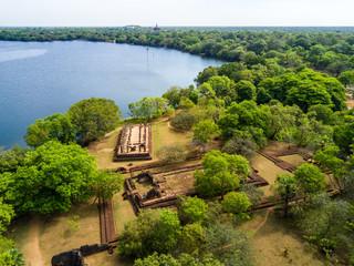 Palace Complex of King Nishshanka Malla, Nissanka Malla, Kirti Nissanka or Kalinga Lokesvara, Polonnaruwa, Sri Lanka, Asia. Mausoleum. Ruins overgrown by jungle. Shore of Bendiwewa lake