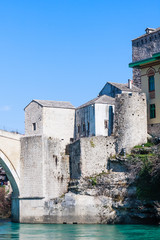 Beautiful view on Mostar city with old bridge and ancient buildings on Neretva river in Bosnia and Herzegovina