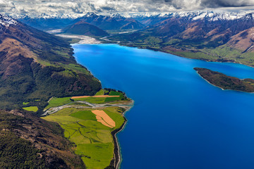 New Zealand, South Island, Otago region. The nothern end of Lake Wakatipu surrounded by Southern Alps, Greenstone River on the left, Pigeon Island on the right, Glenorchy settlement in the background