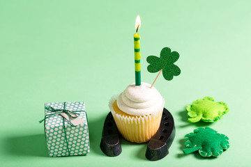 St. Patrick's Day theme with cupcake and decorations