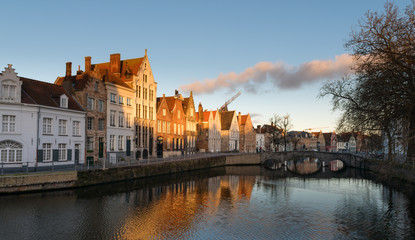 Streets of Bruges in Belgium with its medieval style facades on a cloudy day