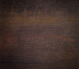 Wood texture abstract background. Top view of a dark rough wood for backdrop. Old brown wooden table with a crack close-up. Surface of vintage wood board with dark nature color and pattern.