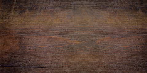 Wood texture abstract background. Top view of a dark rough wood for backdrop. Old brown wooden table with a crack. Surface of vintage wood board or laminate with dark natural color and pattern.