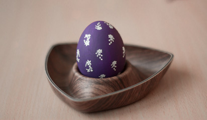 beautifully painted Easter egg on a light background