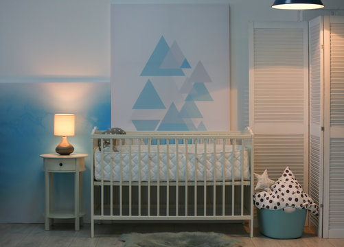 Baby bedroom interior with crib and beautiful decor elements
