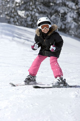 A Young Girl Snow Skiing