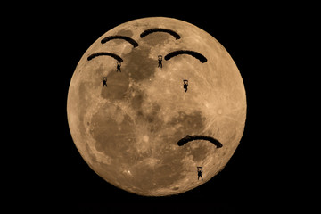 illustration of five parachutes attack team landing in the night scene with big full moon background