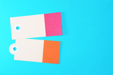 red and orange rectangle paper tags on blue background