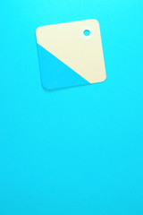 square paper tag on blue background vertical template