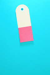 curved rectangle paper tag on blue background vertical template