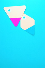 diamond and triangle paper tags on blue background vertical template