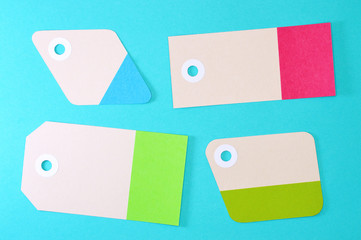 diamond and rectangles paper tags on blue background