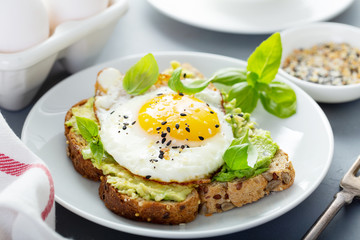 Avocado toast with fried sunny side up egg