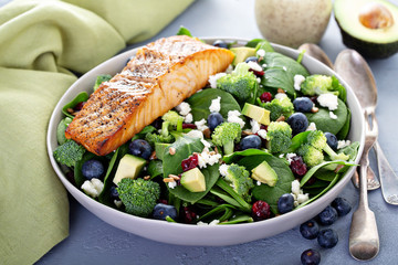 Fresh spinach and feta salad with blueberries, and broccoli, and salmon