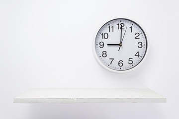 wall clock and shelf on white background
