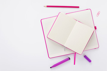 notebook and pencil at white background