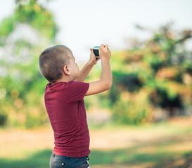 Little cute boy with camera