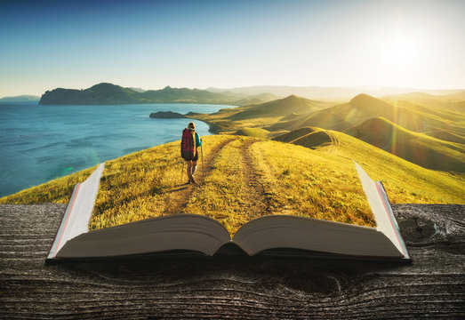 Girl hiker on the pages of book