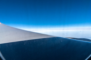 wing of plane in the sky
