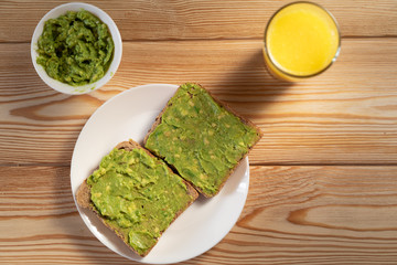 Toasts with avocado guacamole. Diet breakfast. Delicious and healthy plant-based food.