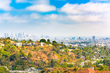 Urban views of the Beverly Hills area and residential buildings on the Hollywood hills.