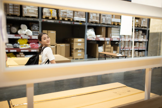 Woman shopping for furniture in warehouse