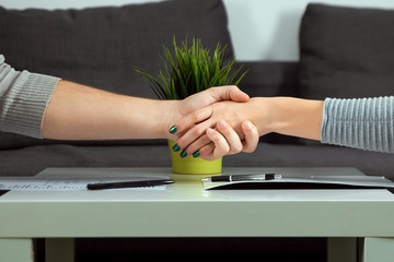 Man and woman shake hands close-up. Family quarrel, showdown, property division, divorce agreement