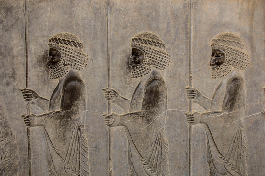 Bas-relief  depicts guards - warriors of king. Ancient relief on the wall of the ruined city of Persepolis. Iran.