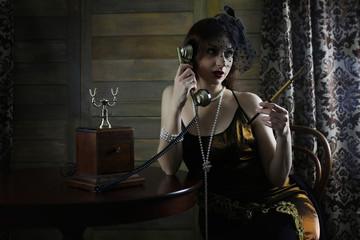 Beautiful 1930s girl smokes