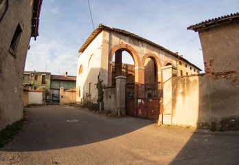 barn with brick arches in a state of neglect, in a country town.Lombardy - Italy