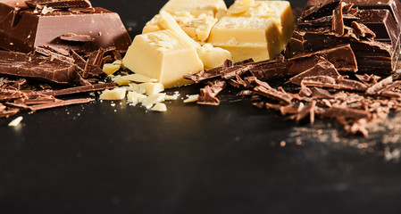 Close-up of white and milk chocolate on kitchen