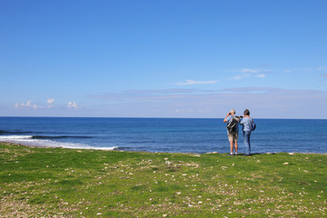 Seniors take a walk and take pictures on the Mediterranean Sea, Paphos - Cyprus