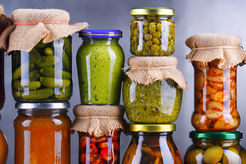Jars with variety of pickled vegetables and fruits