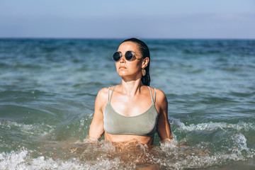 Pretty long hair brunette girl relaxing in the sea.