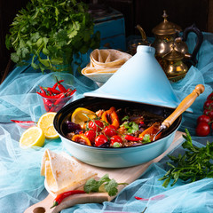 Tasty spicy beef with various vegetables cooked in tagine